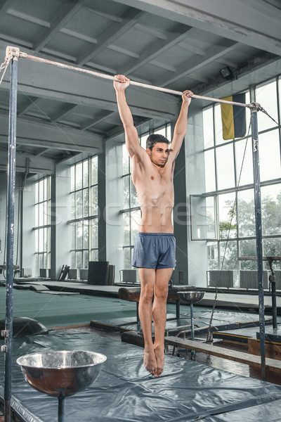 Male gymnast performing handstand on parallel bars Stock photo © master1305