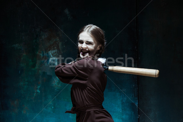 Portrait of a young girl in school uniform as killer woman Stock photo © master1305