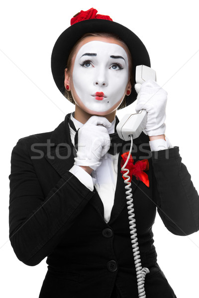 Woman in the image mime holding a handset.  Stock photo © master1305