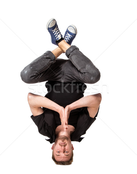 Young handsome fresh man breakdancing on white background Stock photo © master1305