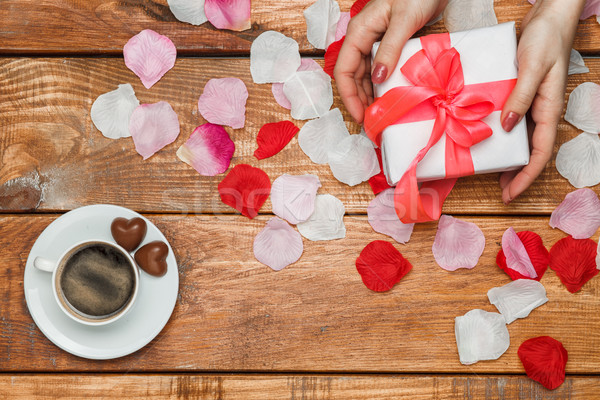 Valentines Day gift and Female hands on wooden background  Stock photo © master1305