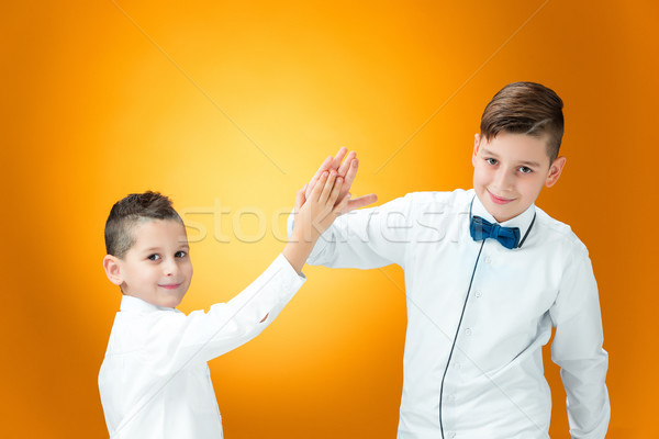 Happy children congratulating by palms with the victory Stock photo © master1305