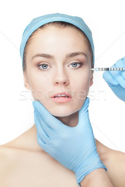 Chirurgie esthétique seringue visage blanche main Photo stock © master1305