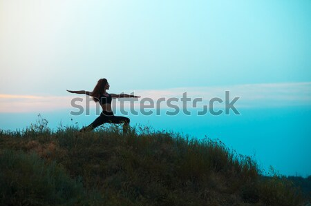 The silhouette of young woman is practicing yoga Stock photo © master1305