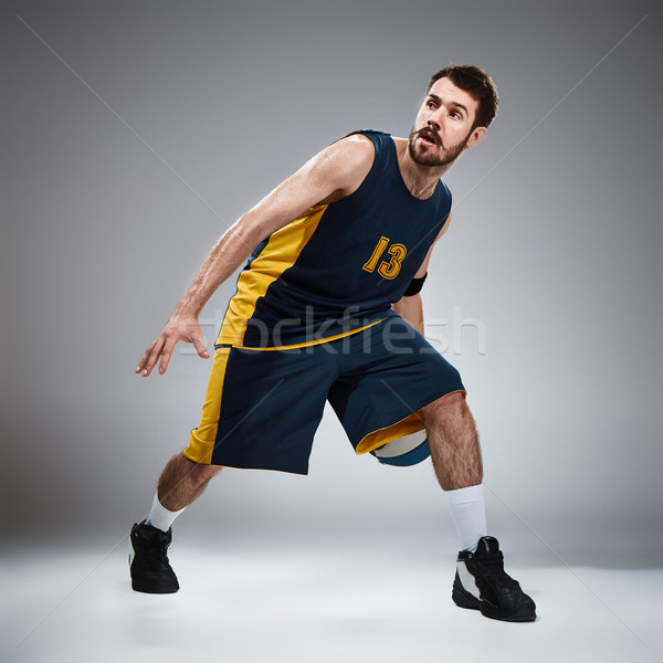 Full length portrait of a basketball player with ball  Stock photo © master1305