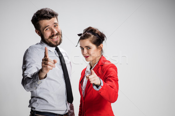 The business man and woman on a gray background Stock photo © master1305