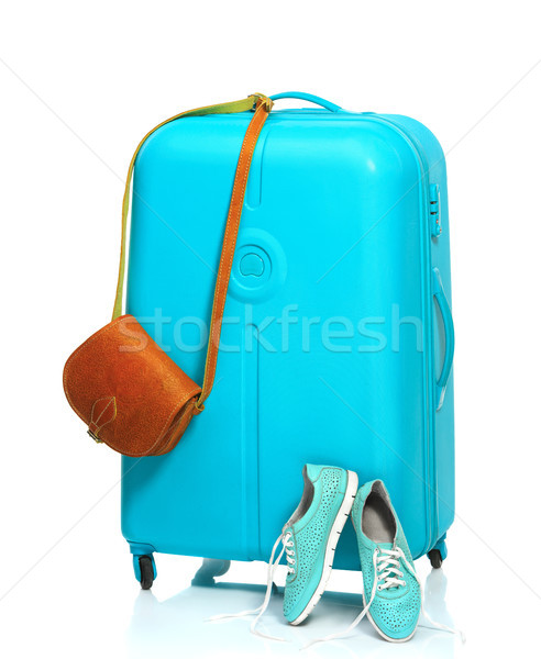 The blue suitcase, sneakers, handbag on white background. Stock photo © master1305