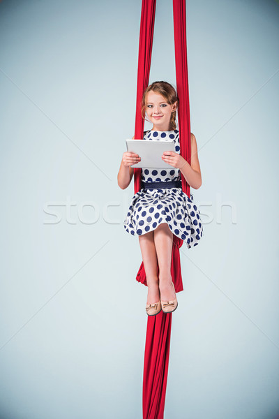 Graceful gymnast sitting with laptop Stock photo © master1305