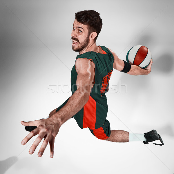 Full length portrait of a basketball player with  ball against gray studio background Stock photo © master1305
