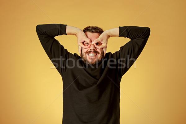 Portré fiatalember boldog arckifejezés narancs stúdió Stock fotó © master1305