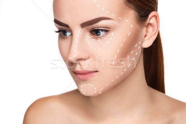 The beautiful woman face with arrows close up over white background Stock photo © master1305
