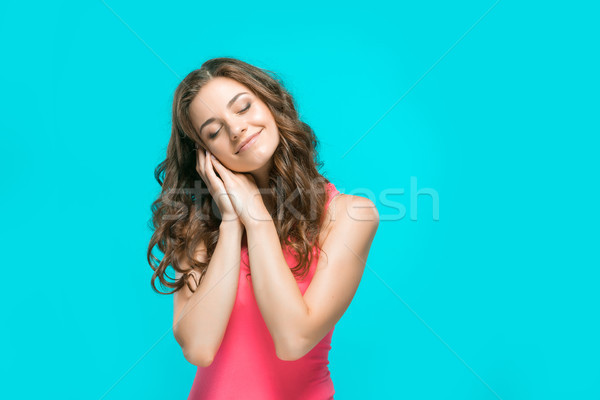 Stock photo: The young woman's portrait with thoughtful emotions