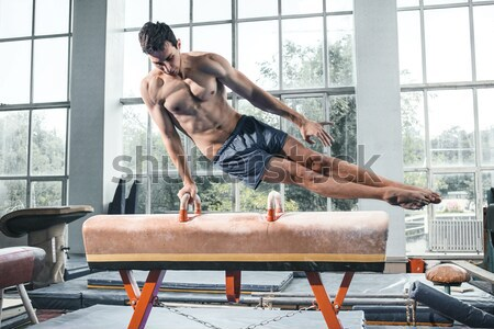 The sportsman during difficult exercise, sports gymnastics Stock photo © master1305
