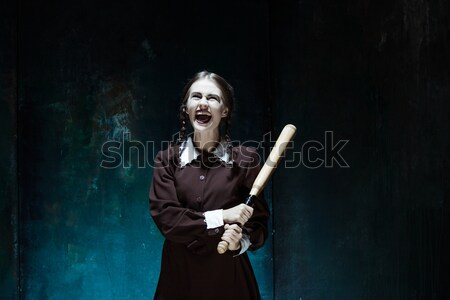 Bloody Halloween theme: crazy girl with a knife and raw meat Stock photo © master1305