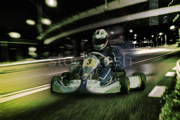 Karting - driver in helmet on kart circuit Stock photo © master1305