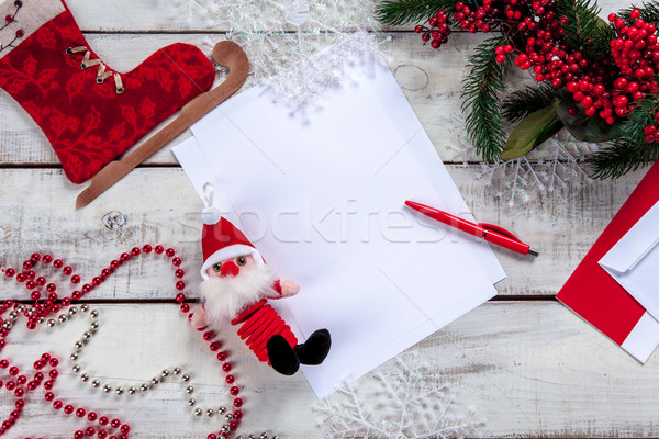 Stock photo: The blank sheet of paper on the wooden table with a pen