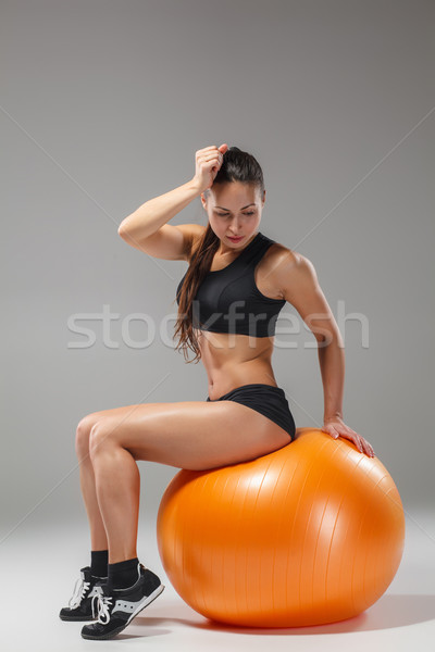 Stock photo: The young, beautiful, sports girl doing exercises on a fitball