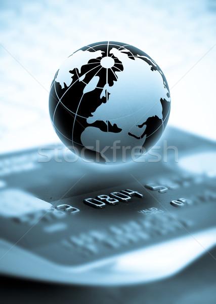 Pénzügy kép pénz hitelkártyák üzlet földgömb Stock fotó © mastergarry