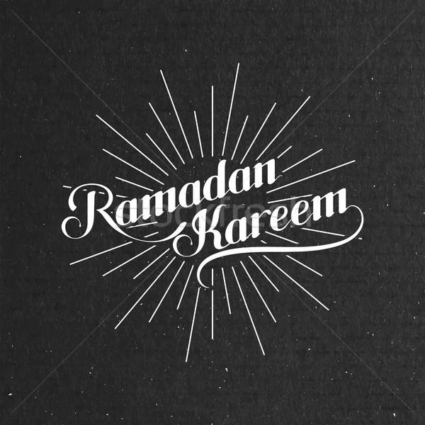 Stock photo:  illustration of handwritten Ramadan Kareem retro label with lig