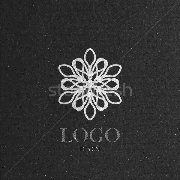 vector illustration with a graceful snowflake on cardboard texture. Logo design  Stock photo © maximmmmum