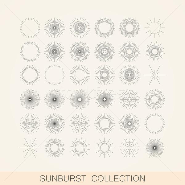 vector set of geometric sunburst and light ray shapes. design element collection Stock photo © maximmmmum