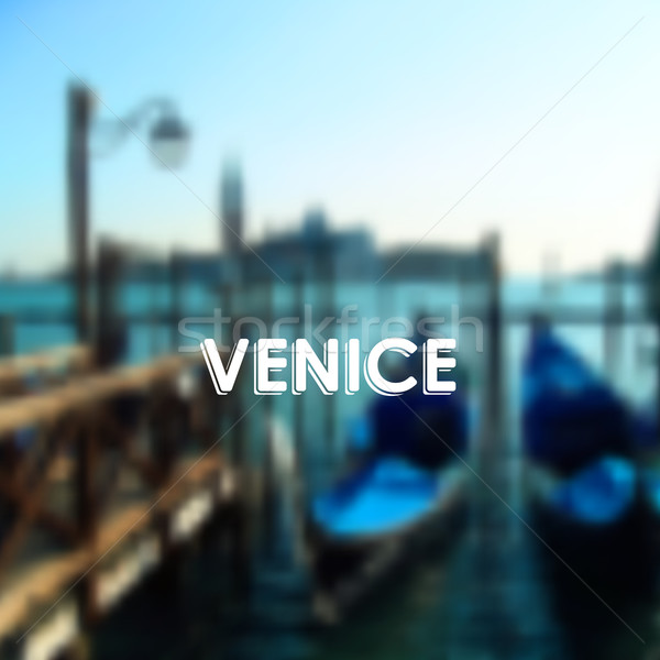vector illustration of gondolas in Venice lagoon, Italy. Blurred cityscape with typographic label  Stock photo © maximmmmum