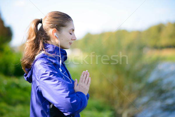 Young Beautiful Woman Meditate on the River Stock photo © maxpro