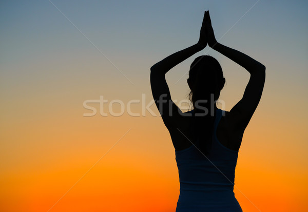 Young Beautiful Woman Practices Yoga on the Sunset Stock photo © maxpro