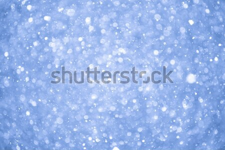 Abstract Blue Christmas Background with Real Snow. Blurred Snowflakes. Stock photo © maxpro