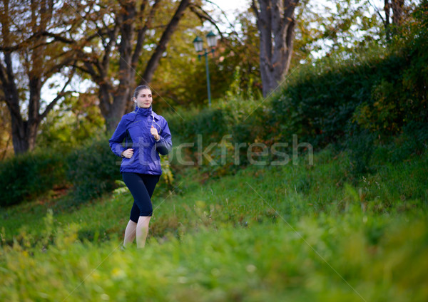 Stock photo: Young Beautiful Woman Running in the Park