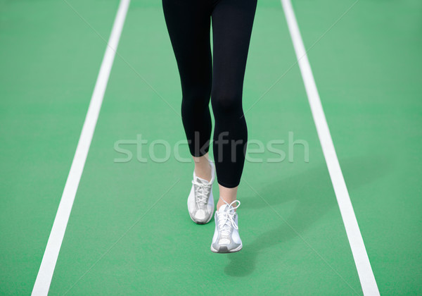 Woman Athlete Runner Feet Running on Green Running Track. Fitness and Workout Wellness Concept. Stock photo © maxpro