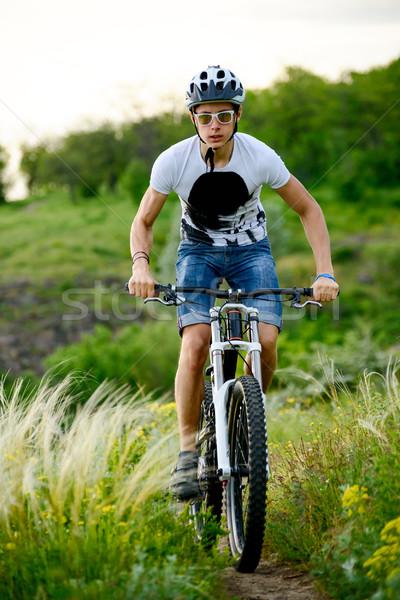 Cyclist Riding the Bike on Beautiful Spring Mountain Trail Stock photo © maxpro