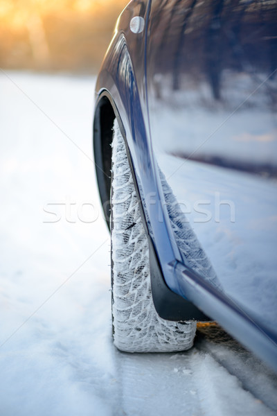 Stock photo: Close-up Image of Winter Car Tire on the Snowy Road. Drive Safe.