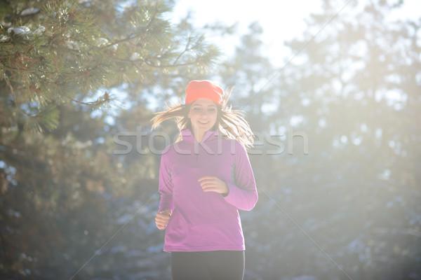 Fiatal nő fut gyönyörű tél erdő napos Stock fotó © maxpro