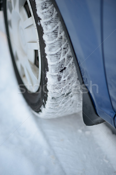 Stock photo: Close-up Image of Winter Car Tire on Snowy Road. Drive Safe Concept.