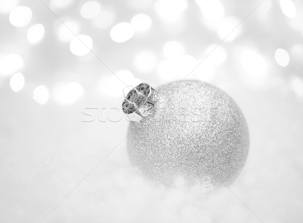 Stock photo: Christmas Decoration with White Ball in the Snow on the Blurred Background with Lights. Greeting Car