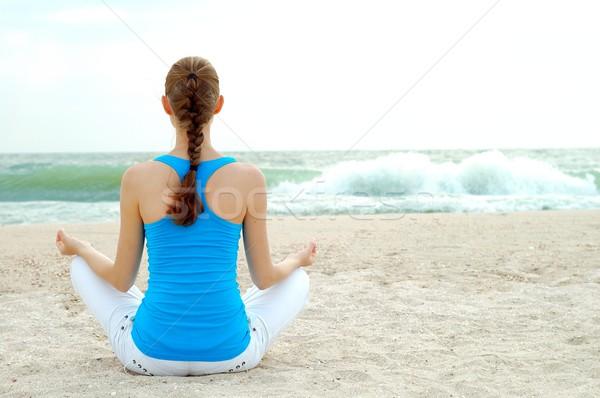 Beautiful woman practice yoga on the beach Stock photo © maxpro
