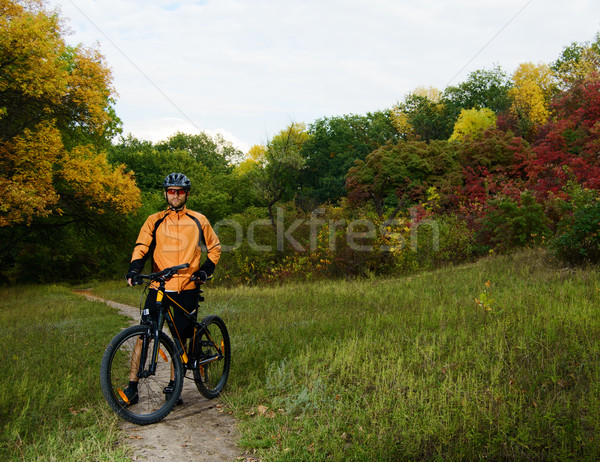 Cyclist with Bike in the Beautiful Autumn Forest Stock photo © maxpro