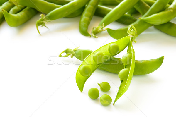 Stock photo: Fresh Sweet Green Pea Pods and Ceeds Isolated on White Background