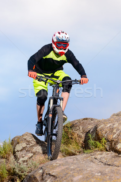 Professional Cyclist Riding the Bike on the Top of the Rock. Extreme Sport Concept. Stock photo © maxpro