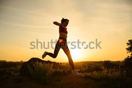 Silhouette of Man Running on the Rocky Trail at Sunset. Extreme Sports. Stock photo © maxpro