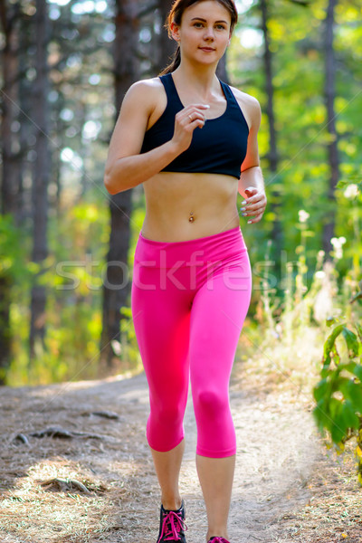 Young Woman Running on the Trail in the Beautiful Wild Forest. Active Lifestyle Concept. Space for T Stock photo © maxpro
