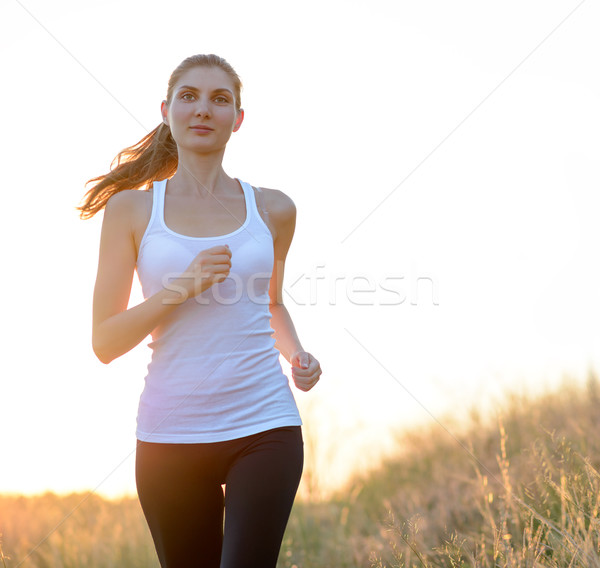 Stock photo: Young Beautiful Woman Running on the Mountain Trail in the Morning