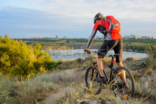 Stock photo: Cyclist Riding the Bike on the Beautiful Spring Mountain Trail