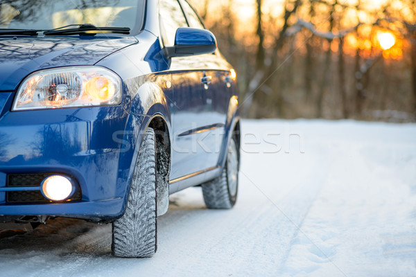 Blue Car with Winter Tires on the Snowy Road. Drive Safe. Stock photo © maxpro