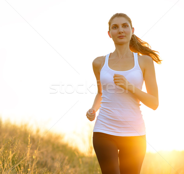 Young Beautiful Woman Running on the Trail in the Morning Stock photo © maxpro