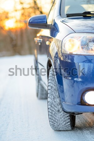Stock photo: Blue Car with Winter Tires on the Snowy Road. Drive Safe.
