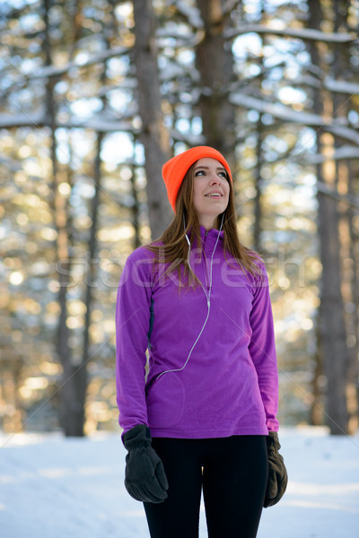 Stock photo: Young Woman Runner Smiling and Looking Up in Beautiful Winter Forest at Sunny Frosty Day. Active Lif
