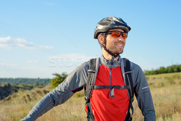 Portrait of Young Cyclist in Helmet and Glasses Stock photo © maxpro