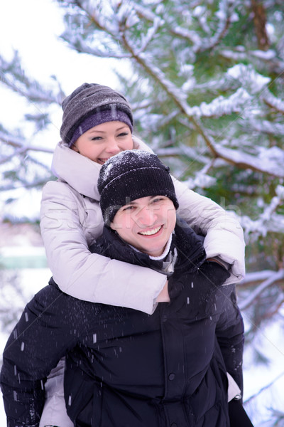Young Beautiful Couple Taking Fun and Smiling Outdoors in Winter Stock photo © maxpro